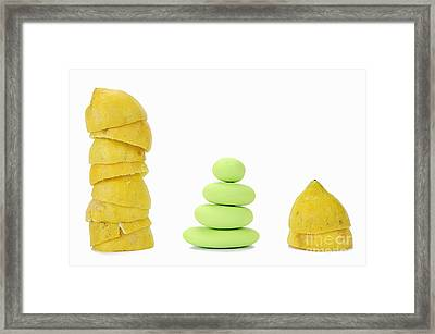 Squeezed Yellow Citrus And Pebbles Framed Print
