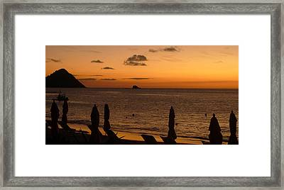 St. Lucia - Sundown - Closed Umbrellas Framed Print by Nora Boghossian