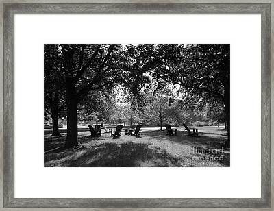 St. Olaf College Adirondacks On The Quad Framed Print by University Icons