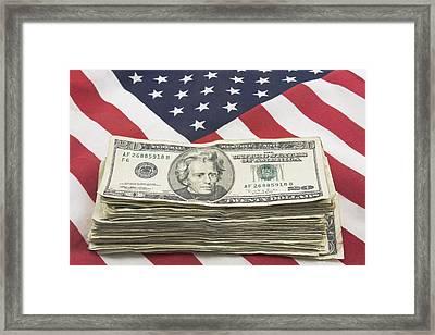 Stack Of Money On American Flag  Framed Print