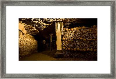 Stacked Bones In Catacombs, Paris Framed Print