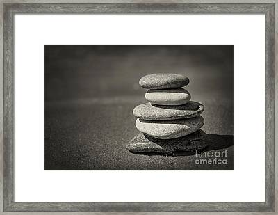 Stacked Pebbles On Beach Framed Print