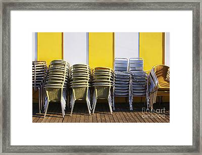 Stacks Of Chairs And Tables Framed Print by Carlos Caetano