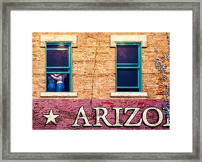 Standing On A Corner Framed Print by Dave Bowman