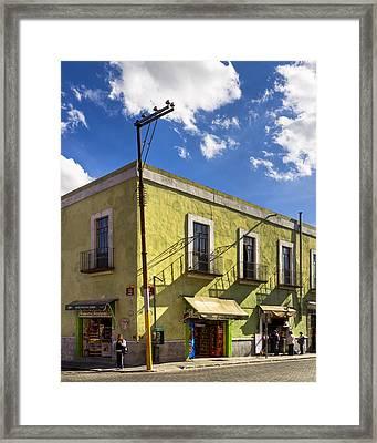 Standing On A Street Corner In Puebla Framed Print