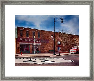 Standing On The Corner Framed Print by Fred Larson
