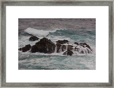 Framed Print featuring the photograph Standing Up To The Waves by Suzanne Luft
