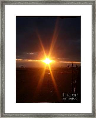 Star Shaped Sunset Over Coney Island Framed Print by John Telfer