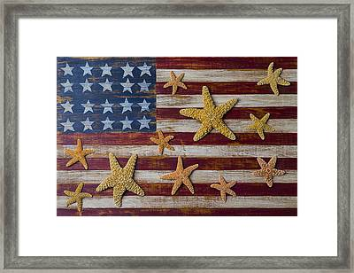 Starfish On American Flag Framed Print by Garry Gay