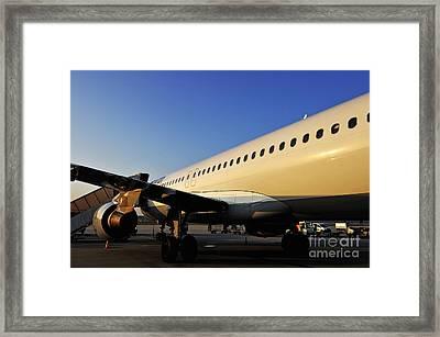 Stationary Airplane On Tarmac At Sunrise Framed Print by Sami Sarkis