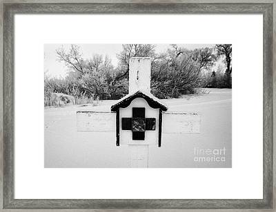 stations of the cross in a graveyard during winter in Forget Saskatchewan Canada Framed Print