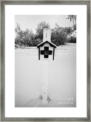 stations of the cross in a graveyard during winter in Forget Saskatchewan Framed Print by Joe Fox