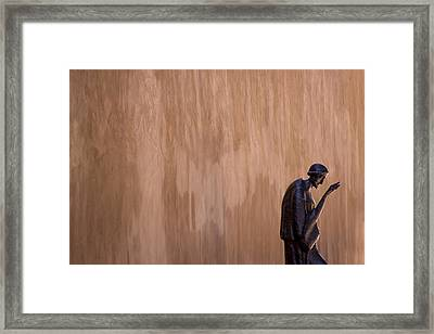 Statue Against Adobe Wall Santa Fe Framed Print by Carol Leigh