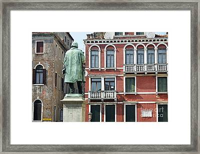 Statue And Building Facade Framed Print