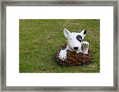 Statue Of A Dog Decorated On The Lawn Framed Print by Tosporn Preede
