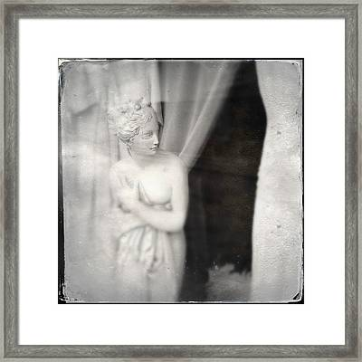 Statue Of A Woman In Shop Window Framed Print