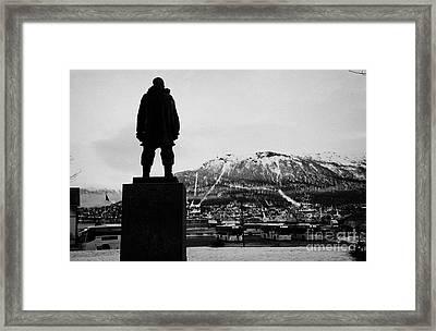 statue of adventurer roald amundsen looks out over Tromso harbour and  floya mountain troms Norway e Framed Print