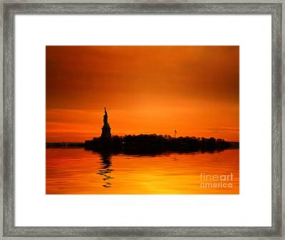 Statue Of Liberty At Sunset Framed Print by John Farnan