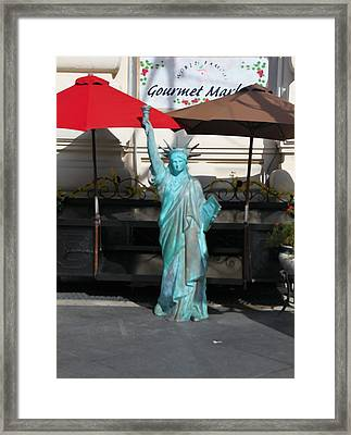 Statue Of Liberty At The Market Framed Print by Dan Sproul