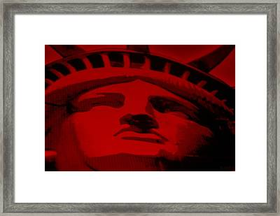 Statue Of Liberty In Red Framed Print by Rob Hans