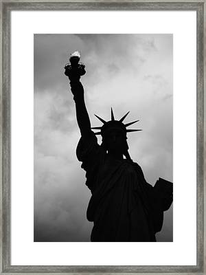 Framed Print featuring the photograph Statue Of Liberty Silhouette by Dave Beckerman
