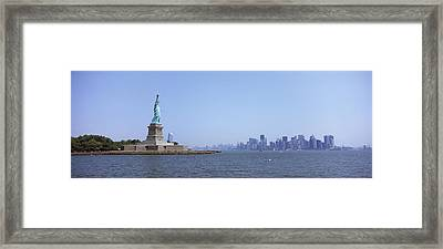 Statue Of Liberty With Manhattan Framed Print