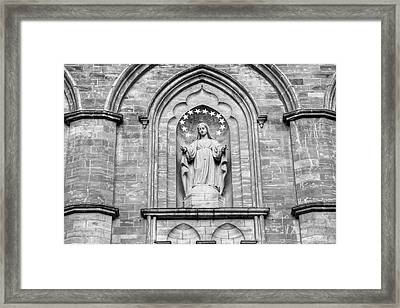 Statue On Facade Of Notre Dame Church Framed Print