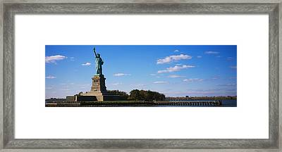 Statue Viewed Through A Ferry, Statue Framed Print by Panoramic Images