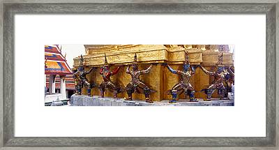 Statues At Base Of Golden Chedi, The Framed Print by Panoramic Images
