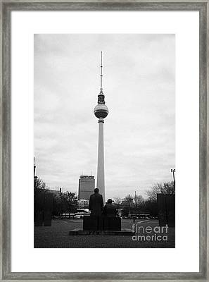 statues of Marx and Engels in the Marx Engels Forum looking at the berliner fernsehturm Berlin TV tower symbol of east berlin Germany Framed Print