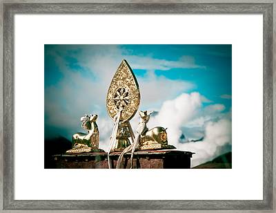 Stautes Of Deer And Golden Dharma Wheel Framed Print