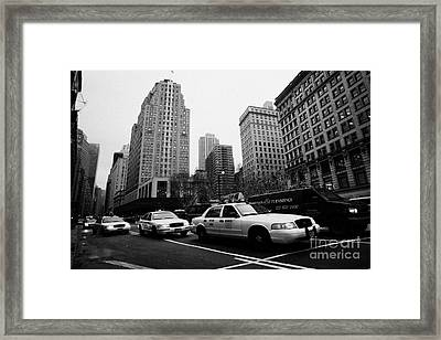 Steam Of Yellow Cabs With Headlights On Heading Down Broadway At Herald Square Outside Macys Nyc Usa Framed Print
