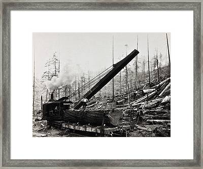 Steam Loader Loading Logs C. 1890 Framed Print by Daniel Hagerman