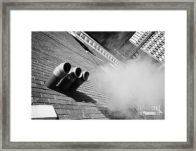 steam venting from plastic exhaust pipes on old brick building downtown Saskatoon Saskatchewan Canad Framed Print by Joe Fox