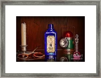 Steampunk Bottled Light Framed Print by Paul Ward