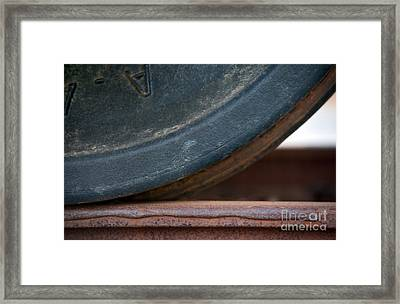 Steel Wheel Framed Print by Dan Holm