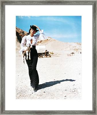Stella Tennant Carrying A Lamb Framed Print by Arthur Elgort