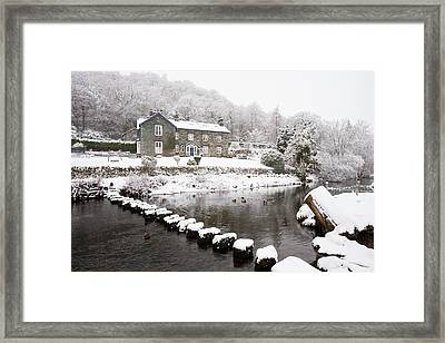 Stepping Stones Across A River Framed Print by Ashley Cooper