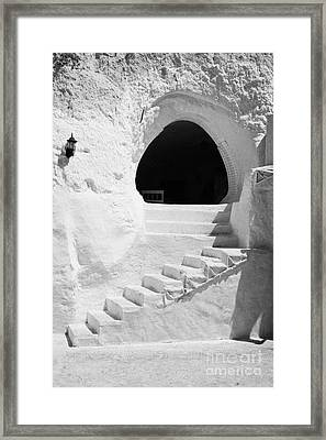 steps up to the entrance of one of the caves at the Sidi Driss Hotel underground at Matmata Tunisia scene of Star Wars films vertical Framed Print