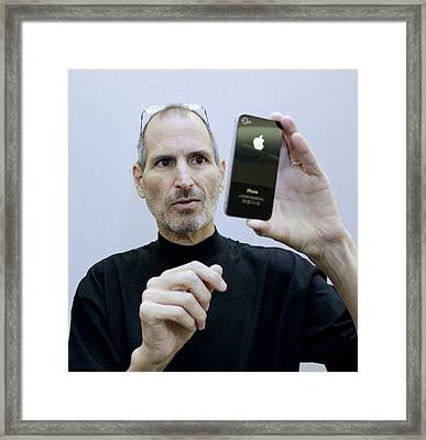 Steve Jobs Holding An Iphone 4 Framed Print by Science Photo Library