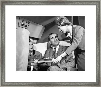 Stewardess Serving Food Framed Print