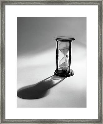 Still Life Of Hourglass With Sand Framed Print