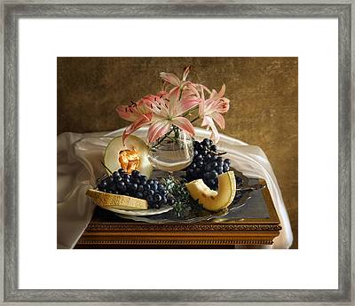 Still Life With Lily Flowers And Melon Framed Print by Vitaliy Gladkiy