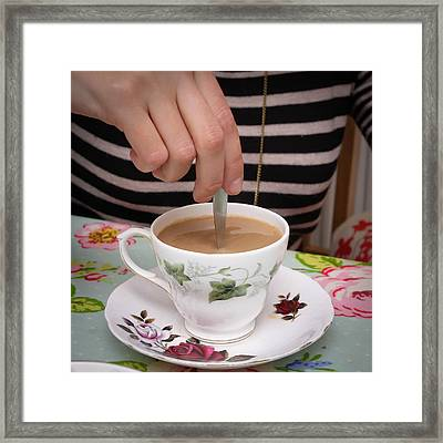 Stirring Tea  Framed Print