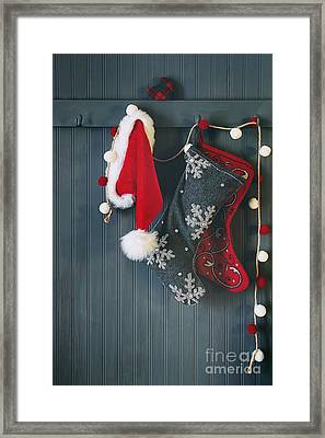 Framed Print featuring the photograph Stockings Hanging On Hooks For The Holidays by Sandra Cunningham