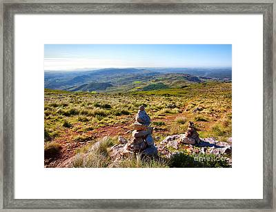 Stone Cairns Framed Print by Carlos Caetano