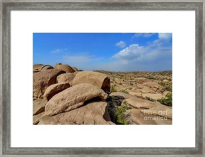 Stone Caves Framed Print by George Paris