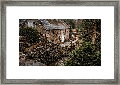 Stone Home By The Stream Framed Print