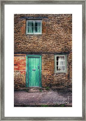 Stone House With Green Door Framed Print