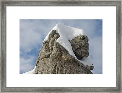Stone Lion Covered With Snow Framed Print